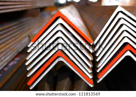 The arrangement of steel angles bunch in warehouse.
