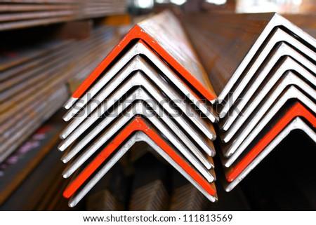The arrangement of steel angles bunch in warehouse.