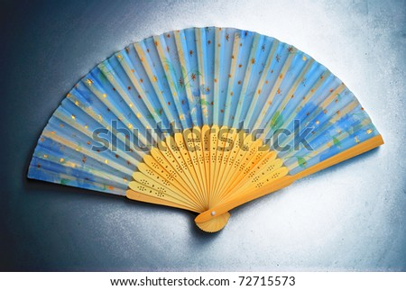 The art hand fan is in the airbrush background