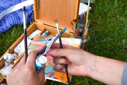 The artist draws on nature. Oil painting. Art art outdoor. The study in the fresh air. The artist's tools.