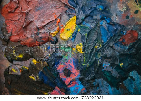 The artist's palette with multicolored paint strokes. Multicolored background #728292031