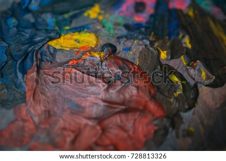 The artist's palette with multicolored paint strokes. Multicolored background #728813326