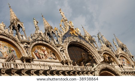 The artistic facade of the famous Basilica di San Marco (St. Mark's Cathedral) at Piazza San Marco (St. Mark's Square) in Venice, Italy