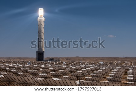 The Ashalim Solar Thermal Power Station in the Negev desert in Israel with one of the tallest solar power tower in the world and more than 50000 computer-controlled mirrors-heliostats.