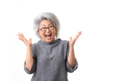 The Asian senior woman on the white background.