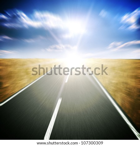 The asphalt road with cloudy sky and sunlight on background #107300309