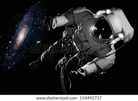"""The astronaut  in outer space""""Elements of this image furnished by NASA"""""""