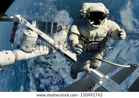 """The astronaut on a background of a planet  """"Elemen ts of this image furnished by NASA"""""""