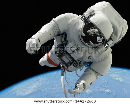"The astronaut on a background of a planet  ""Elements of this image furnished by NASA"""