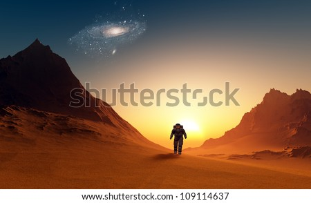 The astronaut on the background of the planet
