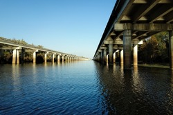 The Atchafalaya Basin Bridge and the Interstate 10 (I-10) highway seen from below on the water level of the Atchafalaya bayou on sunny late November evening in 2012 near Henderson, Louisiana.