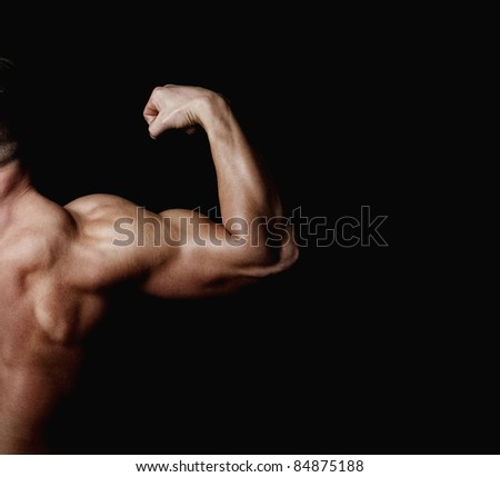 The athlete shows his powerfull arm and shoulder