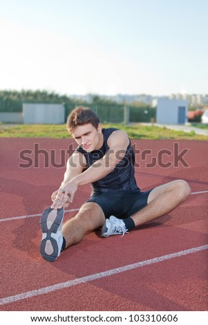 The athlete warming up at the stadium.