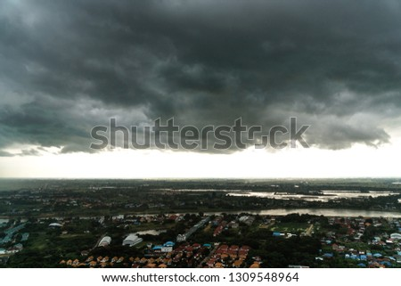 The atmosphere before storm and rain with a great black cloud in countyside Thailand.