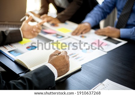 The atmosphere in the startup's meeting room was attended by three delegates to brainstorm and plan the company's operations. Young businessmen form startups and are growing higher. Startup idea.