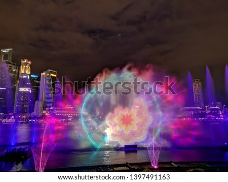 the atmosphere of the city of Singapore at night with the beauty of the fountain and colorful lights, Marina Bay, Singapore on May 1, 2019