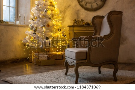 The atmosphere of the holiday. New Year's interior. Wall clock with fireplace and Christmas tree #1184371069