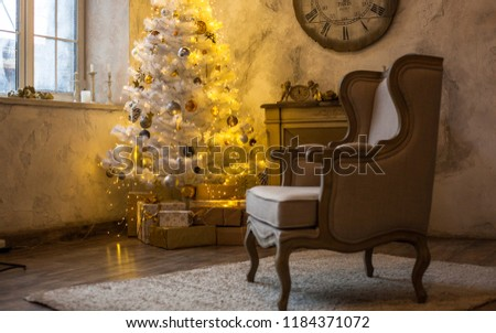 The atmosphere of the holiday. New Year's interior. Wall clock with fireplace and Christmas tree #1184371072