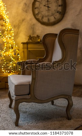 The atmosphere of the holiday. New Year's interior. Wall clock with fireplace and Christmas tree #1184371078
