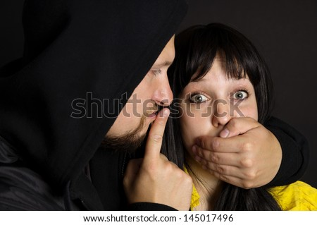 The attack on the girl, the man threatened the victim - stock photo