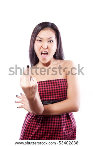 The attractive Asian girl in a beautiful red dress and bad gesture