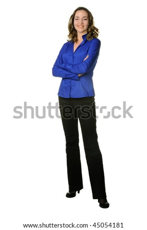 The attractive girl in trousers and dark blue shirt. It is isolated on a white background