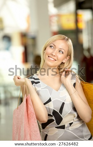 The attractive woman in shop has control over purchases