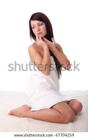The attractive young woman in towel on a white background.  Concept spa.