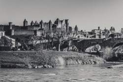 The Aude River and Old Bridge (Pont Vieux, 14th Cent) leading to Medieval town of Carcassonne (Cite), France.