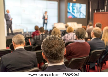 The audience listens to the acting in a conference hall #272092061