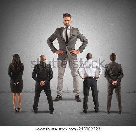 The authoritarian boss in front of his employees