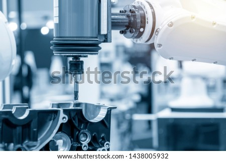 The automotive parts milling with flat endmill tool attach the robotic arm. The aluminium casting parts finishing process by milling cutter attach robotics spindle. #1438005932