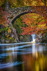 The autumn colours on Black Linn Falls at the Hermitage on the River Braan near Dunkeld in Perthshire