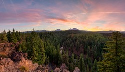 The autumn sun sets over Three Sisters in the Cascade Mountains from Bend, Oregon