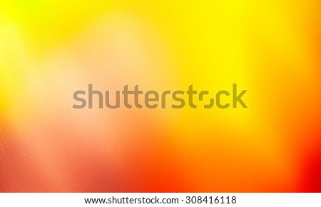 The autumn sun texture, abstract background. Shining warm colors of autumn. Blurry textures
