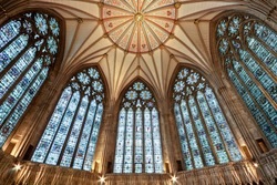 The awe inspiring roof and stained glass windows of The Chapter House at York Minster (completed 1286 AD)