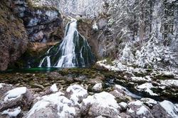 The awe-inspiring waterfall in Golling in Winter.