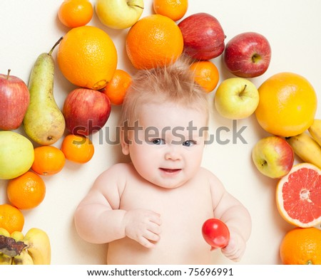 The babe in an environment of the fresh fruit