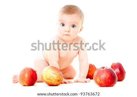 The babe in an environment of the fresh fruit, isolated on the white