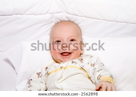 the baby lies on white pillow