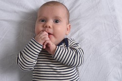 the baby who plays with his hands until he sucks his finger