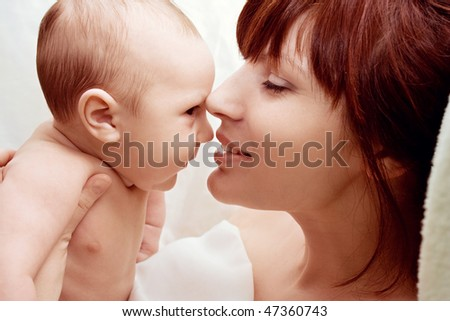 the baby with mum - stock photo