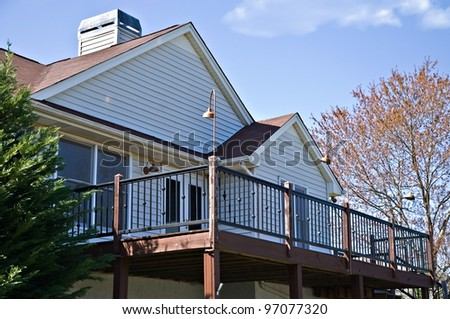 The back deck area of a home, with metal railing.