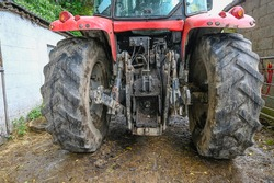The back end of a tractor showing the power take of point and 3 point linkage,