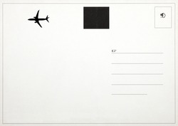 The back of an old postcard with air-mail symbol and blank space for text.