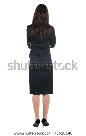 The back of beautiful young woman looking at wall. Rear view. Isolated over white.