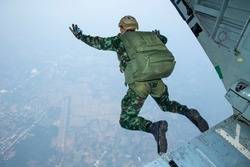 The back of Rangers parachuted from military airplanes, Thai Soldiers parachuted from the plane, isolated airborne soldier, practice parachuting, Paratroopers jumping from an airplane.