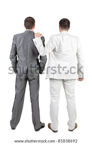 The back of two business men discuss. Rear view. Isolated over white background.