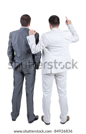 The back of two businessmen discuss. Rear view. Isolated over white background.