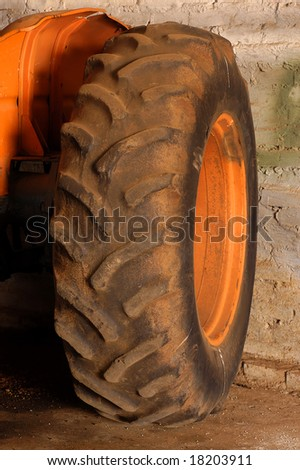 The back tyre of an old tractor